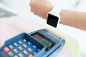 57585678 - customer paying with nfc technology with smart watch